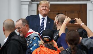 President Donald Trump visits with members of Bikers for Trump and supporters, Saturday, Aug. 11, 2018, outside the clubhouse of Trump National Golf Club in Bedminster, N.J. (AP Photo/Carolyn Kaster)
