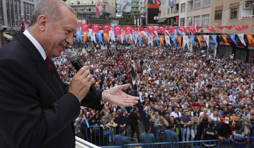 Turkey's President Recep Tayyip Erdogan addresses his supporters in his Black Sea hometown, Rize, Turkey, Saturday, Aug. 11, 2018.(Presidential Press Service via AP, Pool)