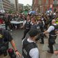 "D.C. Metropolitan Police and Secret Service officers were forced back by counterprotesters outside of a security barrier on 17th street while attempting to escort attendees of the ""Unite the Right 2"" rally from Lafayette Park in Northwest. (Associated Press)"