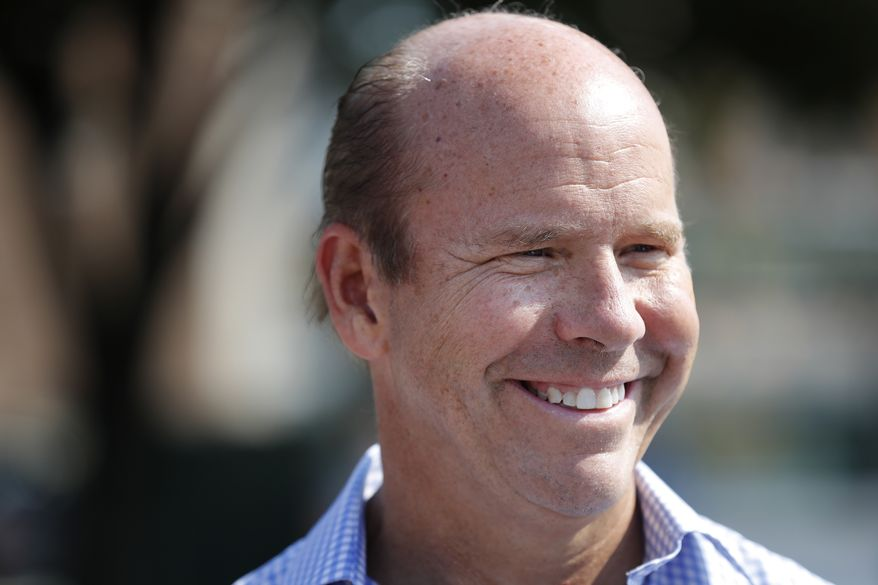 Rep. John Delaney, D-Md., speaks to fairgoers during a visit to the Iowa State Fair, Friday, Aug. 10, 2018, in Des Moines, Iowa. (AP Photo/Charlie Neibergall)