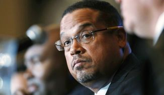 In this Dec. 2, 2016, file photo, U.S. Rep. Keith Ellison, D-Minn., listens during a forum on the future of the Democratic Party, in Denver. On Sunday, Aug. 12, 2018, Ellison denied an allegation from an ex-girlfriend that he had once dragged her off a bed while screaming obscenities at her. The allegation came just days before a Tuesday primary in which the Democrat is among several running for state attorney general. (AP Photo/David Zalubowski, File)