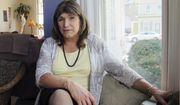 File - In this Feb. 21, 2018 file photo, transgender utility executive Christine Hallquist poses for a photo during an interview in Johnson, Vt. Hallquist is one of four Democrats seeking the party's nomination for Vermont governor in the Tuesday, Aug. 14 primary election. (AP Photo/Wilson Ring, File)
