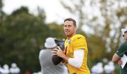 Washington Redskins' Alex Smith warms up at NFL football training camp in Richmond, Va., Sunday, Aug. 12, 2018. (AP Photo/Parker Michels-Boyce)