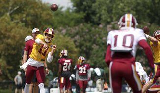 Washington Redskins quarterback Alex Smith (11) runs drills at NFL football training camp in Richmond, Va., Sunday, Aug. 12, 2018. (AP Photo/Parker Michels-Boyce)