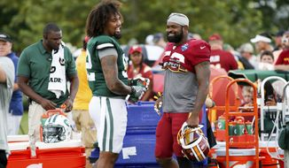 New York Jets Leonard Williams (92) and Washington Redskins Zach Brown (53) talk before NFL football training camp in Richmond, Va., Sunday, Aug. 12, 2018. (AP Photo/Parker Michels-Boyce) ** FILE **