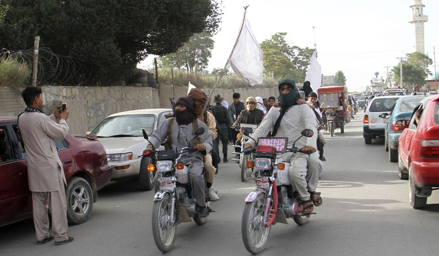 FILE -  In this June 16, 2018 file photo, Taliban fighters ride their motorbikes inside Ghazni city, capital of Ghazni province, west of Kabul, Afghanistan. An Afghan official said Sunday, Aug. 12, 2018, that security forces are battling the Taliban for the third straight day following a massive insurgent attack into the key city of Ghazni. The Taliban pushed into Ghazni from different directions on Friday and destroyed a telecommunication tower, cutting off landline and cell phone communications. (AP Photo, File)