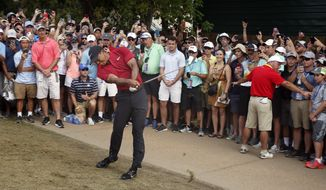 Tiger Woods hits to the ninth green during the final round of the PGA Championship golf tournament at Bellerive Country Club, Sunday, Aug. 12, 2018, in St. Louis. (AP Photo/Brynn Anderson)