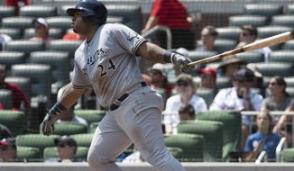 Milwaukee Brewers' Jesus Aguilar watches his three-run home run during the fourth inning of a baseball game against the Atlanta Braves, Sunday, Aug. 12, 2018, in Atlanta. (AP Photo/John Amis)