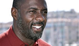 In this file photo dated Tuesday, April 14, 2015, actor Idris Elba poses for photographers during the MIPTV, International Television Programme Market, in Cannes, southern France. (AP Photo/FILE)