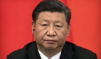 FILE - In this June 8, 2018, file photo, Chinese President Xi Jinping attends a signing ceremony at the Great Hall of the People in Beijing. Just months after clearing the way to rule in perpetuity president and ruling Communist Party leader Xi Jinping is best by a wave of economic, foreign policy and domestic political challenges. (AP Photo/Mark Schiefelbein, File)
