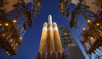The Mobile Service Tower is rolled back to reveal the United Launch Alliance Delta IV Heavy rocket with the Parker Solar Probe onboard, Saturday, Aug. 11, 2018, Launch Complex 37 at Cape Canaveral Air Force Station in Fla. A last-minute technical problem Saturday delayed NASA's unprecedented flight to the sun. Rocket maker United Launch Alliance said it would try again Sunday, provided the helium-pressure issue can be resolved quickly. Once on its way, the Parker probe will venture closer to our star than any other spacecraft.  (Bill Ingalls/NASA via AP)
