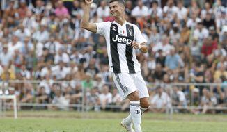 Juventus' Cristiano Ronaldo takes part in a friendly match between the Juventus A and B teams, in Villar Perosa, northern Italy, Sunday, Aug.12, 2018. (AP Photo/Antonio Calanni)