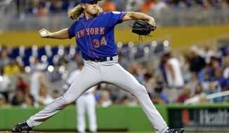 New York Mets starting pitcher Noah Syndergaard throws against the Miami Marlins in the fourth inning during their baseball game in Miami, Sunday, Aug. 12, 2018. (AP Photo/Joe Skipper)
