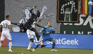 Vancouver Whitecaps' Kei Kamara (23) scores on a header against the Portland Timbers during an MLS soccer match Saturday, Aug. 11, 2018, in Portland, Ore. (Kent Frasure/The Oregonian via AP)