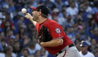 Washington Nationals starting pitcher Max Scherzer throws against the Chicago Cubs during the first inning of a baseball game Sunday, Aug. 12, 2018, in Chicago. (AP Photo/Nam Y. Huh)