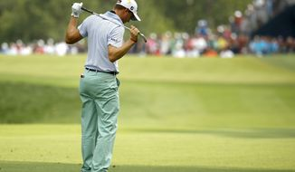 Justin Thomas reacts to his shot after hitting from the 14th fairway during the final round of the PGA Championship golf tournament at Bellerive Country Club, Sunday, Aug. 12, 2018, in St. Louis. (AP Photo/Charlie Riedel)