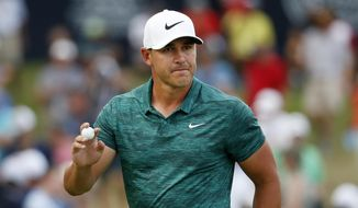 Brooks Koepka waves to the crowd after making his birdie putt on the 15th green during the final round of the PGA Championship golf tournament at Bellerive Country Club, Sunday, Aug. 12, 2018, in St. Louis. (AP Photo/Jeff Roberson)