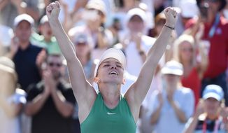 Simona Halep of Romania reacts after defeating Sloane Stephens of the United States to win the final of the Rogers Cup tennis tournament Sunday, Aug. 12, 2018 in Montreal. (Paul Chiasson/The Canadian Press via AP)