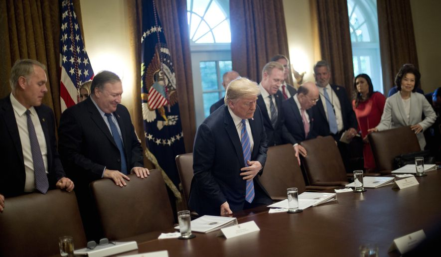 """In this July 18, 2018, file photo, President Donald Trump, center, takes his seat before the start of his meeting with members of his Cabinet in the Cabinet Room of the White House in Washington. Also taking their seats are from left, Interior Secretary Ryan Zinke, Secretary of State Mike Pompeo, Deputy Secretary of Defense Patrick Shanahan, Commerce Secretary Wilbur Ross, White House deputy chief of staff for communications Bill Shine, White House press secretary Sarah Huckabee Sanders and Transportation Secretary Elaine Chao. For years Shine carried out Roger Ailes' orders, earning himself the nicknamed """"the Butler"""" at Fox. Now, Shine is serving the same role under Trump. Shine has yet to select a permanent office or unpack his stuff. But he has been putting his mark on the West Wing. (AP Photo/Pablo Martinez Monsivais, File)"""