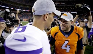 Denver Broncos quarterback Case Keenum, right, greets Minnesota Vikings quarterback Kirk Cousins after an NFL football preseason game Saturday, Aug. 11, 2018, in Denver. (AP Photo/Jack Dempsey)