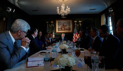 President Donald Trump meets with state leaders about prison reform, Thursday, Aug. 9, 2018, at Trump National Golf Club in Bedminster, N.J. (AP Photo/Carolyn Kaster)
