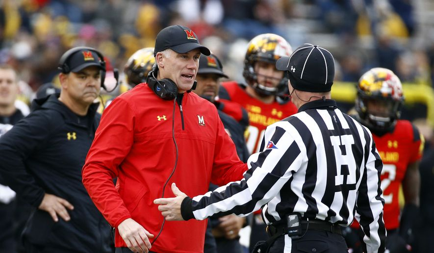 Maryland head coach DJ Durkin speaks with an official in the first half of an NCAA college football game against Michigan in College Park, Md., Saturday, Nov. 11, 2017. (AP Photo/Patrick Semansky) **FILE**
