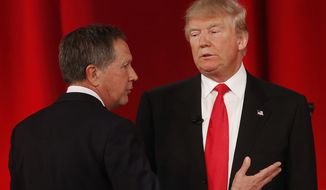 Republican presidential candidate, Ohio Gov. John Kasich, left, speaks to Republican presidential candidate, businessman Donald Trump  during a commercial break during the CBS News Republican presidential debate at the Peace Center, Saturday, Feb. 13, 2016, in Greenville, S.C. (AP Photo/John Bazemore)
