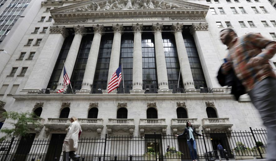 FILE - In this Oct. 24, 2017, file photo people pass the New York Stock Exchange. The U.S. stock market opens at 9:30 a.m. EDT on Monday, Aug 13. (AP Photo/Richard Drew)