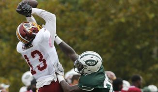 Washington Redskins wide receiver Maurice Harris (13) grabs a pass over New York Jets defensive back Terrence Brooks (23) during the New York Jets Washington Redskins NFL football training camp in Richmond, Va., Monday, Aug. 13, 2018. (AP Photo/Steve Helber) ** FILE **