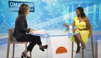 "This image released by NBC Today shows reality TV personality and former White House staffer Omarosa Manigault Newman during an interview with co-host Savanah Guthrie on the ""Today"" show on Monday, Aug. 13, 2018, in New York. Manigault Newman was promoting her book ""Unhinged."" (Zach Pagano/NBC via AP)"