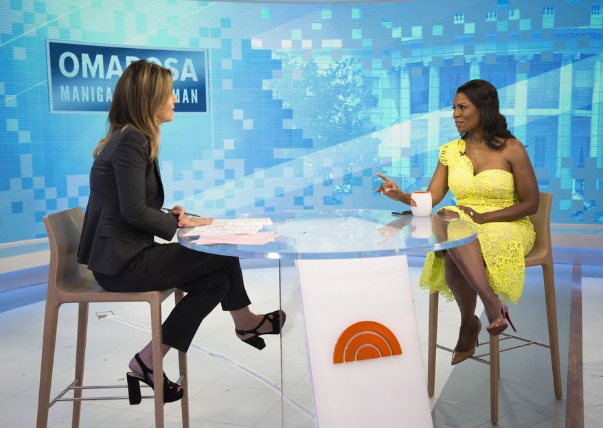 """This image released by NBC Today shows reality TV personality and former White House staffer Omarosa Manigault Newman during an interview with co-host Savanah Guthrie on the """"Today"""" show on Monday, Aug. 13, 2018, in New York. Manigault Newman was promoting her book """"Unhinged."""" (Zach Pagano/NBC via AP)"""