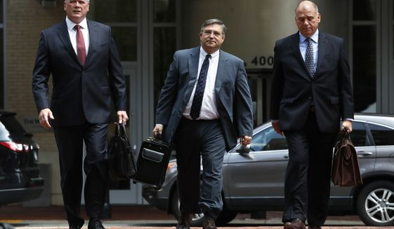 Members of the defense team for Paul Manafort, including Kevin Downing, left, Richard Westling, and Thomas Zehnle, walk to federal court as the trial of the former Trump campaign chairman continues, in Alexandria, Va., Monday, Aug. 13, 2018.  (AP Photo/Jacquelyn Martin)