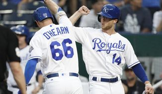 Kansas City Royals' Ryan O'Hearn (66) is congratulated by Brett Phillips (14) after hitting a two-run home run in the second inning of a baseball game against the Toronto Blue Jays at Kauffman Stadium in Kansas City, Mo., Monday, Aug. 13, 2018. (AP Photo/Colin E. Braley)