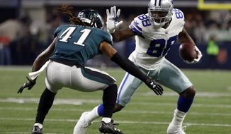 File-This Nov. 19, 2017, file photo shows Philadelphia Eagles cornerback Ronald Darby (41) defends as Dallas Cowboys' Dez Bryant gains extra yardage after catching a pass in the first half of an NFL football game in Arlington, Texas. Browns wide receiver Jarvis Landry says he would love for Bryant to join him in Cleveland. Landry said Monday, Aug. 13, 2018, that he has been in touch with Bryant, a three-time Pro Bowler who was released in April by the Dallas Cowboys.(AP Photo/Ron Jenkins, File)