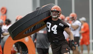 In this Thursday, July 26, 2018, file photo, Cleveland Browns defensive end Carl Nassib runs a drill during NFL football training camp, in Berea, Ohio. Browns defensive end Nassib needs to work on more than his pass rushing skills in training camp. His grandma wants him to clean up his language. (AP Photo/Tony Dejak, File)