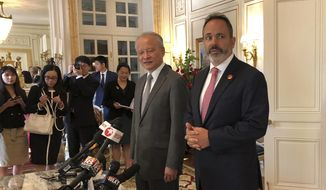 Kentucky Gov. Matt Bevin, right, and Chinese Ambassador to the United States Cui Tiankai speak with reporters at the Governor's Mansion on Monday, Aug. 13, 2018, in Frankfort, Ky. Tiankai met with Kentucky's Republican governor Monday to discuss economic development opportunities amid a growing trade dispute between the world's largest economies. (AP Photo/name)
