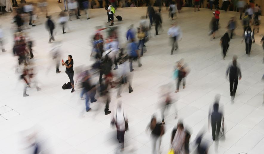 In this June 15, 2017, file photo, people walk inside the Oculus, the new transit station at the World Trade Center in New York. Data collection practices of tech firms are increasingly under the microscope. An Associated Press investigation shows that using Google services on Android devices and iPhones allows the search giant to record your whereabouts as you go about your day. (AP Photo/Frank Franklin II, File)