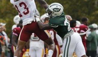 Washington Redskins wide receiver Maurice Harris (13) grabs a pass over New York Jets defensive back Terrence Brooks (23) during the New York Jets Washington Redskins NFL football training camp in Richmond, Va., Monday, Aug. 13, 2018. (AP Photo/Steve Helber)