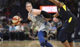 File-This July 3, 2018, file photo shows Minnesota Lynx's Lindsay Whalen being defended by Indiana Fever's Kelsey Mitchell during the first half of a WNBA basketball game in Minneapolis.  Whalen says she'll retire at the end of the season. Whalen has been balancing a new job as coach of the Minnesota Gophers with playing point for the Lynx. Her retirement will end a 15-year career that includes four championships with the Lynx, where the former Gopher star returned in 2010 after beginning her WNBA career in Connecticut.(Jerry Holt/Star Tribune via AP, File)