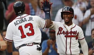 Atlanta Braves left fielder Ronald Acuna Jr. (13) celebrates with Ozzie Albies (1) after hitting a solo-home run in the first inning of the second baseball game of a doubleheader against the Miami Marlins Monday, Aug. 13, 2018 in Atlanta. (AP Photo/John Bazemore)