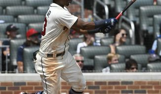 Atlanta Braves' Ronald Acuna Jr. doubles on a line drive to left field for a two run RBI during the sixth inning of the first game in a baseball doubleheader Monday, Aug. 13, 2018, in Atlanta. (AP Photo/John Amis)