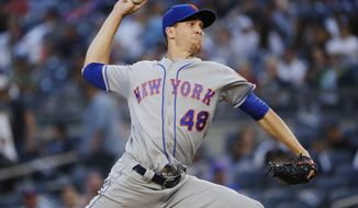 New York Mets' Jacob deGrom delivers a pitch during the first inning of a baseball game against the New York Yankees Monday, Aug. 13, 2018, in New York. (AP Photo/Frank Franklin II)
