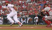 St. Louis Cardinals' Matt Carpenter (13) drops his bat after bunting as Washington Nationals catcher Matt Wieters looks on in the first inning of a baseball game, Monday, Aug. 13, 2018, in St. Louis. (AP Photo/Tom Gannam)