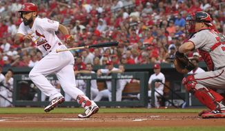 St. Louis Cardinals' Matt Carpenter (13) drops his bat after bunting as Washington Nationals catcher Matt Wieters looks on in the first inning of a baseball game, Monday, Aug. 13, 2018, in St. Louis. (AP Photo/Tom Gannam)