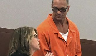 FILE - In this Aug. 17, 2017, file photo, Nevada death row inmate Scott Raymond Dozier, right, confers with Lori Teicher, a federal public defender involved in his case, during an appearance in Clark County District Court in Las Vegas. Two drugmakers are asking Nevada Supreme Court to let a lower court hear arguments before taking up an appeal about whether the state can use their products for an execution. Court filings Monday, Aug. 13, 2018, leave it up to Nevada's highest court to decide how to proceed with a prisons effort to reschedule Dozier's twice-postponed lethal injection. (AP Photo/Ken Ritter, File)