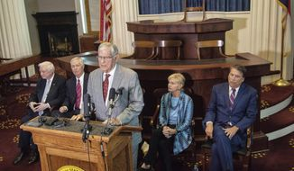 Former North Carolina living ex-governors, from left, Jim Hunt, Mike Easley, Jim Martin, Bev Perdue and Pat McCrory, speak during a press conference opposing proposed amendments to the North Carolina constitution Monday, Aug. 13, 2018, at the North Carolina State Capitol in Raleigh, NC. They say the ammendments would shred gubernatorial power and government checks and balances if approved. (Travis Long/The News & Observer via AP)