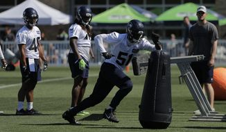 File-This July 26, 2018, file photo shows Seattle Seahawks linebacker Barkevious Mingo (51) running a drill during NFL football training camp, in Renton, Wash.  The Seattle Seahawks would be thrilled if Mingo became the new version of what Bruce Irvin was during their championship run, be strong on stopping the run in early downs, and be a threat as a rusher in passing situations. Doing so would mean Mingo is finally matching the expectation that came with being the No. 6 overall pick five years ago and has only been displayed in brief moments during his first three stops in the NFL.(AP Photo/Ted S. Warren, File)