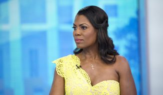 "This image released by NBC Today shows reality TV personality and former White House staffer Omarosa Manigault Newman during an interview on the ""Today"" show on Monday, Aug. 13, 2018, in New York. Manigault Newman was promoting her book ""Unhinged."" (Zach Pagano/NBC via AP)"