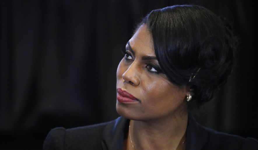 """FILE - In this Feb. 27, 2017 file photo, Omarosa Manigault, director of communications for the White House Office of Public Liaison, listens to Vice President Mike Pence speak during a listening session with the historically black colleges and universities at the Eisenhower Executive Office Building on the White House complex in Washington. Manigault Newman, who was fired in December, released a new book """"Unhinged,"""" about her time in the White House. (AP Photo/Manuel Balce Ceneta, File)"""