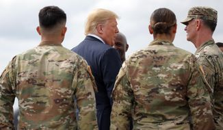 President Donald Trump greets member of the military as he arrives on Air Force One at Wheeler-Sack Army Air Field in Fort Drum, N.Y., Monday, Aug. 13, 2018. (AP Photo/Carolyn Kaster) ** FILE **